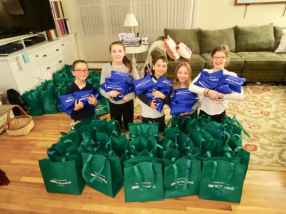 Impact Trumbull Kids Helping